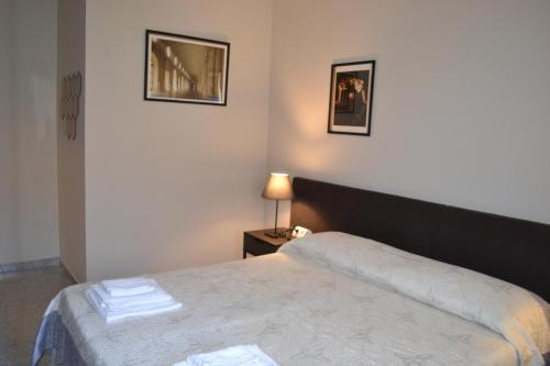 Ein Bett oder Betten in einem Zimmer der Unterkunft A pochi passi