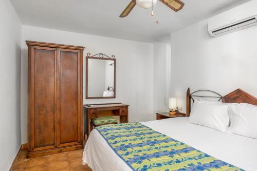 Una cama o camas en una habitación de Sunset Harbour Club By Diamond Resorts