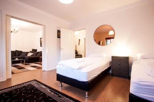 A bed or beds in a room at GreenKey Apartment R44
