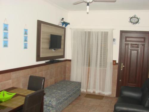 A television and/or entertainment center at Apartamento Costa Esmeralda