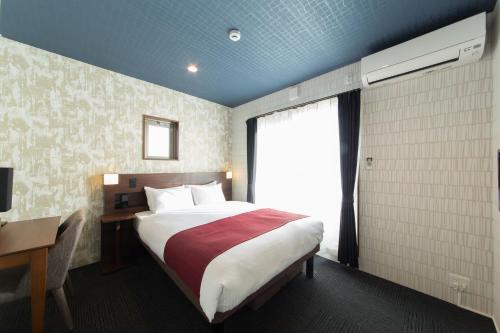 ジャパニングホテル大宮松原にあるベッド
