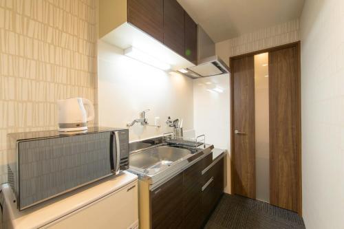 ジャパニングホテル大宮松原にあるキッチンまたは簡易キッチン