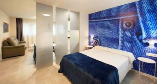 A bed or beds in a room at Apartamentos Divan