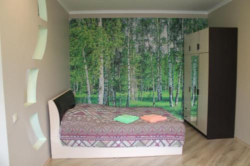 Кровать или кровати в номере Apartment on Sovietskaya