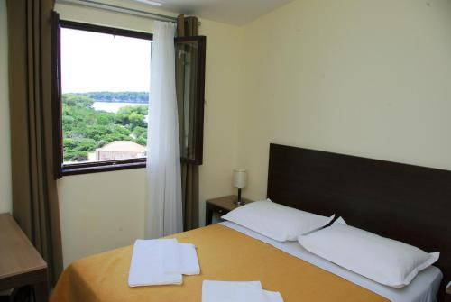 A bed or beds in a room at Hotel Priscapac Resort & Apartments