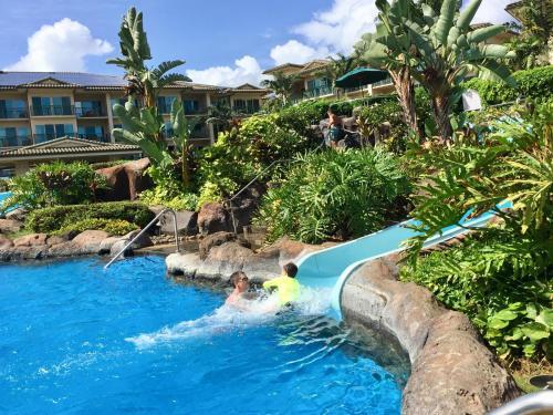 The swimming pool at or near Waipouli Beach Resort B-301
