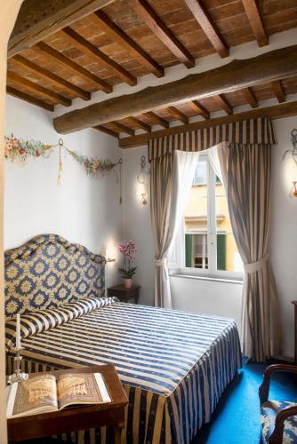 Letto o letti in una camera di Hotel Relais Dell'Orologio