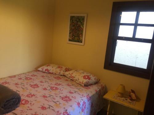 Cama ou camas em um quarto em Chácara Villa Casarão