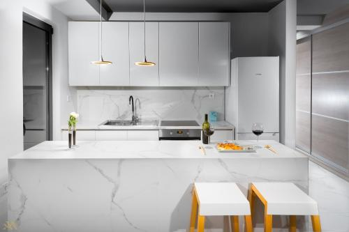 A kitchen or kitchenette at Elysium Boutique Apartments