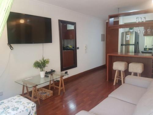Una televisión o centro de entretenimiento en J&F Apartamento Santa Beatriz