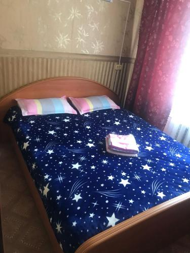 Кровать или кровати в номере Апартамента на Большой 2