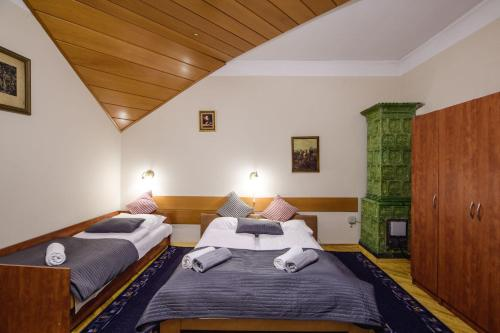 Lova arba lovos apgyvendinimo įstaigoje Golden Lion Szewska 19