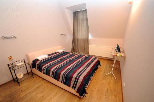 A bed or beds in a room at Made With Love Apartment