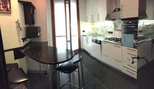 A kitchen or kitchenette at Giulia Luxury Apartment