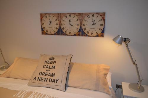Cama o camas de una habitación en El Golf Apartments Chile