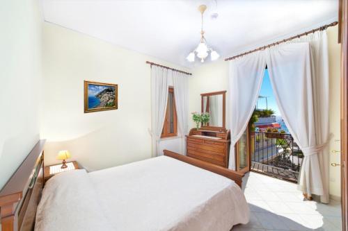 מיטה או מיטות בחדר ב-Villa Costanzo
