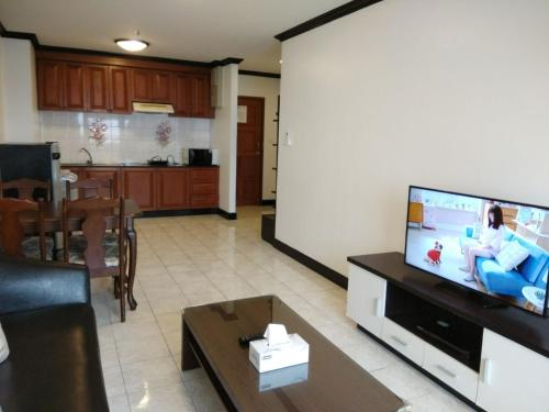 A television and/or entertainment center at Patong Tower by United 21 Thailand