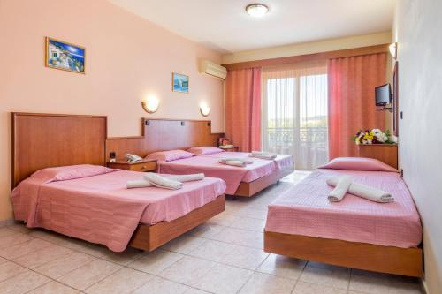 A bed or beds in a room at Alea Hotel Apartments