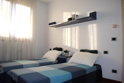 A bed or beds in a room at Residenza Naggi