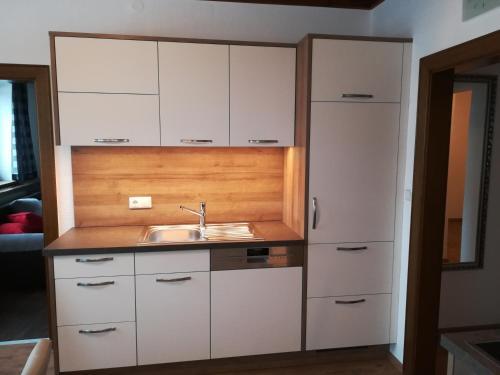 Küche/Küchenzeile in der Unterkunft Pirnbacher