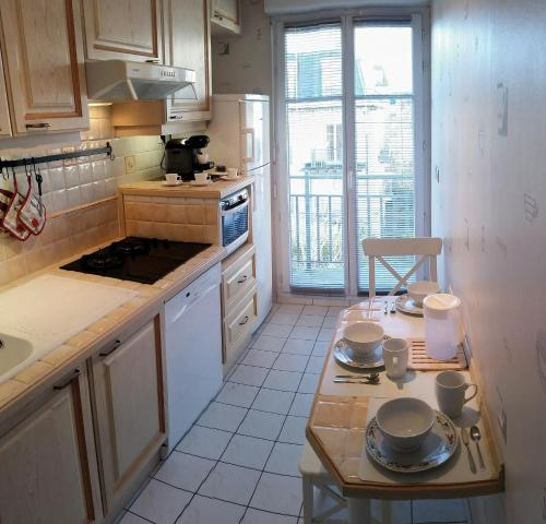 A kitchen or kitchenette at Apartment in Chessy very near Disneyland