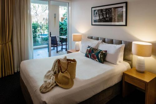 A bed or beds in a room at The Sebel Noosa
