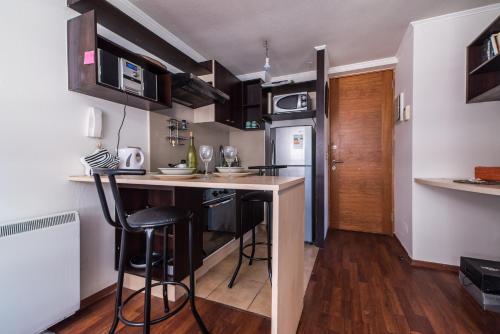 Una cocina o zona de cocina en Apartamentos Riveras 4