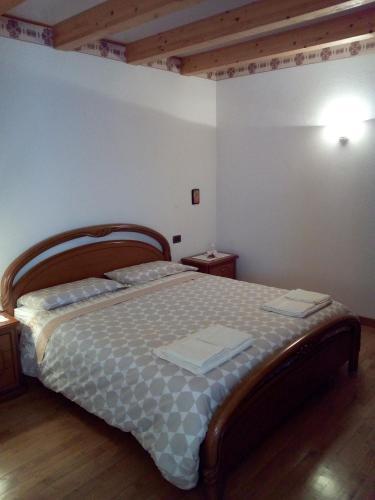 Krevet ili kreveti u jedinici u okviru objekta B&B Bike Il camoscio del Lagorai