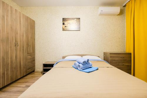 A bed or beds in a room at Apartments na Titova 253/1 VIP