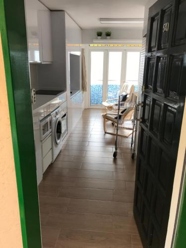 Küche/Küchenzeile in der Unterkunft Apartamento Privado frente al Atlántico