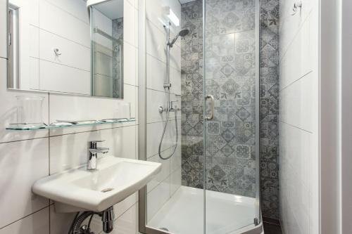 Vonios kambarys apgyvendinimo įstaigoje Old Town Trio Apartments