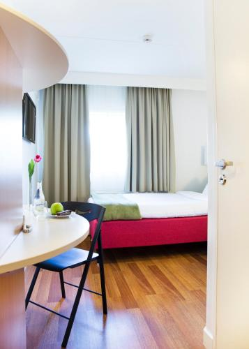 A bed or beds in a room at Good Morning Lund