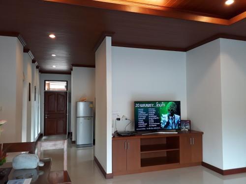A television and/or entertainment center at Baanmanchusa 1 Thai villa