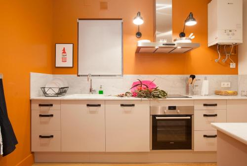 A kitchen or kitchenette at Sealona Center Apartments