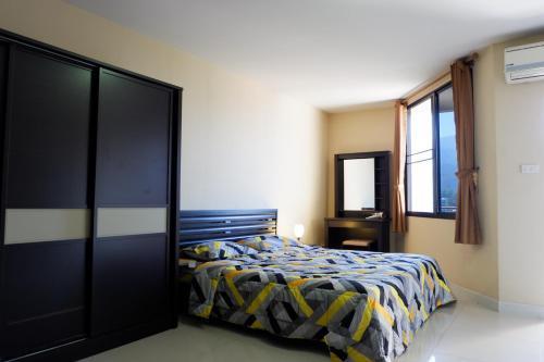 A bed or beds in a room at The Trio Condo by A.P