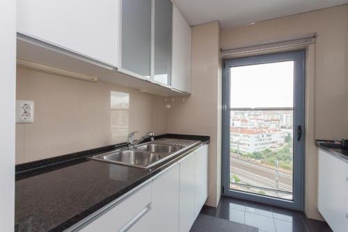 Køkken eller tekøkken på Apartments Lisboa - Parque das Nacoes