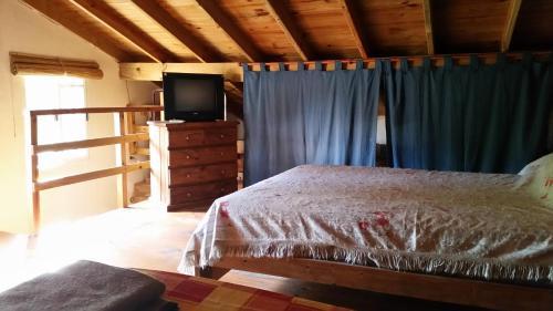 Una cama o camas en una habitación de Duplex Villa Gesell
