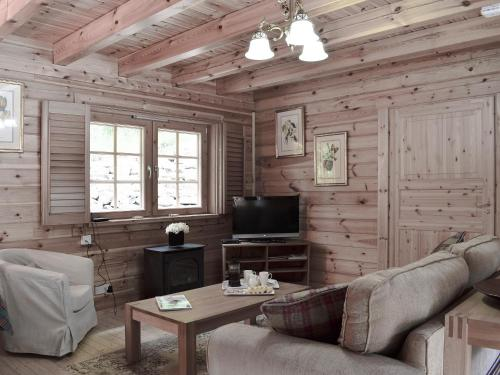 A seating area at Acharn Lodges - Maple