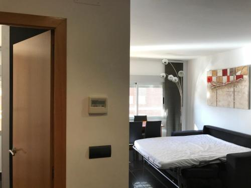 A bed or beds in a room at Apartamentos Benicassim