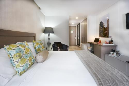 A bed or beds in a room at 100 Luxury Suites