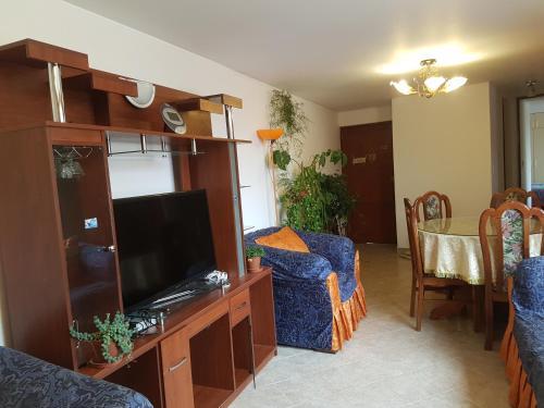 Una televisión o centro de entretenimiento en Departamento residencial en Cuzco