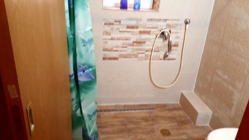 A bathroom at Orhan Or-Hazohar Apartment