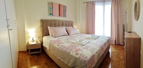 Ένα ή περισσότερα κρεβάτια σε δωμάτιο στο City apartment 17