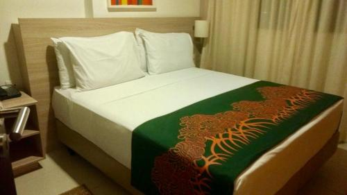A bed or beds in a room at Beach Class Convention