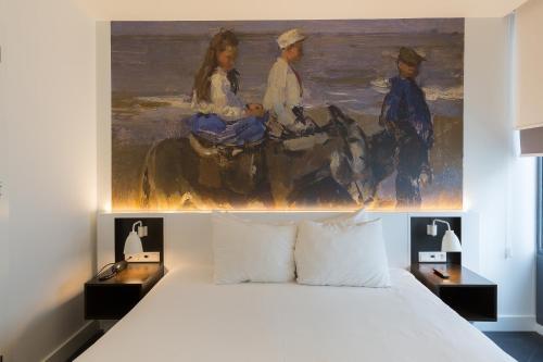 Ein Bett oder Betten in einem Zimmer der Unterkunft B-aparthotel Kennedy