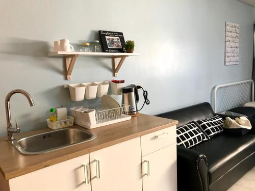 A kitchen or kitchenette at Nesto Condo at Muangthong