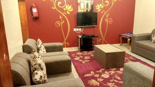 טלויזיה ו/או מרכז בידור ב-Qasr Dalin Furnished Apartments