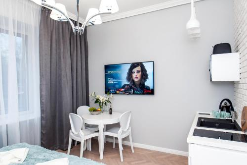 A television and/or entertainment center at Noble Old Town Apartments