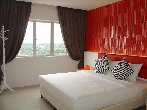 سرير أو أسرّة في غرفة في فندق وسكن دوتا