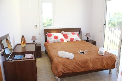 A bed or beds in a room at Villa Triada